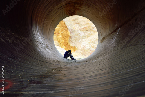 depressed young man sitting in the drain Canvas Print