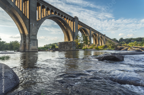 Fotobehang Brug This concrete arch railroad bridge spanning the James River was built by the Atlantic Coast Line, Fredericksburg and Potomac Railroad in 1919 to route transportation of freight around Richmond, VA.