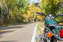 Motorcycle And Open Road In Autumn