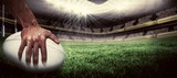 Fototapeta sport - Composite image of close-up of sports player holding ball