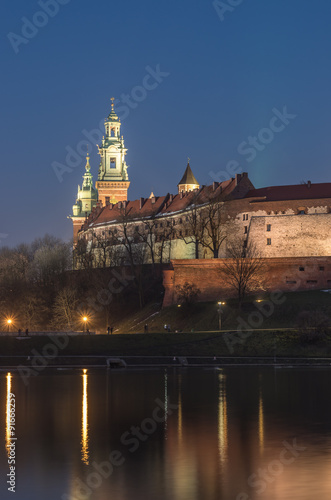Wawel Castle and Wawel cathedral seen from the Vistula boulevards in the evening #91666259