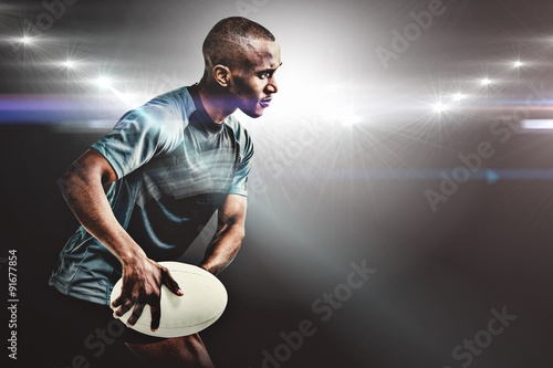 Fotografiet  Composite image of sportsman throwing rugby ball
