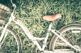 Vintage Bicycle with Summer grassfield,vintage tone style