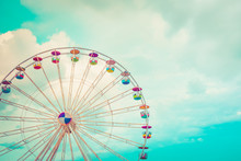 Ferris Wheel On Cloudy Sky Background Vintage Color