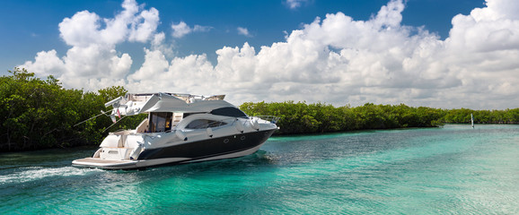 Fototapeta na wymiar Luxury motor yacht sailing out at sea