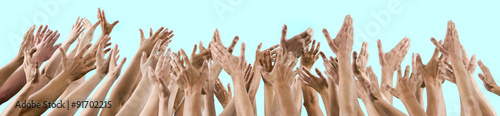 Fotografie, Obraz  isolated lot of men's and women's hands raised up