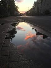 Sunset Puddle Reflection