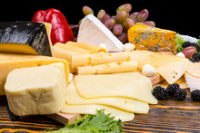 Gourmet Selection Of Cheeses On A Cheeseboard