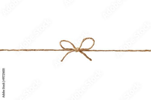 Nahaufnahme Schnur oder Bindfaden gebunden in einem Bogen auf weißem Hintergrund Fototapete