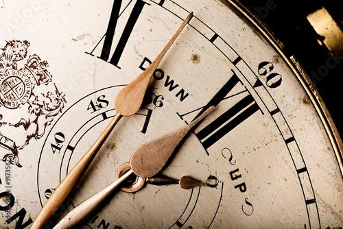 pointers of antique marine chronometer reaching twelve