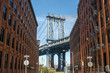 New York City Manhattan Bridge and brick wall buildings