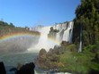 A beautiful wide shot of Iguacu Falls with a rainbow foreground.