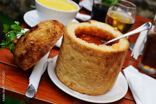 Fényképezés Traditional Romanian beans soup served in bread, from the Sighisoara region of Transylvania