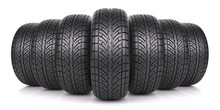 Car Tires In Row Isolated On W...