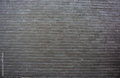 Foto op Plexiglas Hintergrund schwarze Backsteinwand mit Fehlstellen