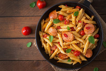 Penne Pasta With Tomatoes And Sausage. Top View
