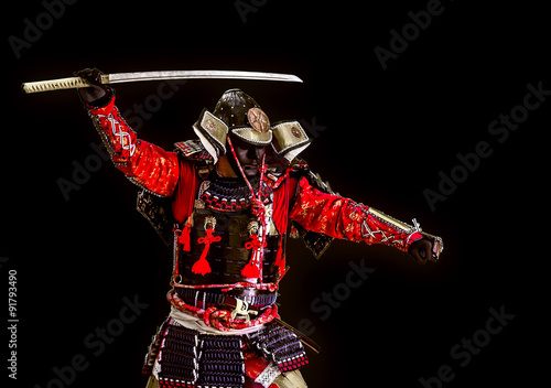 Fotografering  Samurai in ancient armor with a sword attack