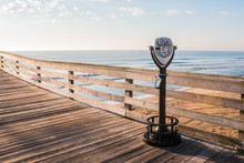 Sightseeing Binoculars With On The Virginia Beach Fishing Pier With Beach Background