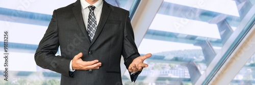 Fotografie, Tablou Man in business suit gestures with hands and says something