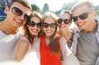 smiling friends taking selfie