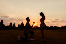 Silhouette Of A Man Makes A Proposal Of Betrothal To His Girlfri
