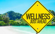 canvas print picture - Wellness Just Ahead sign with beach background