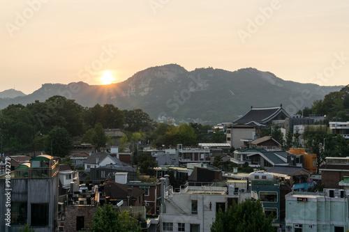 samcheongdong sunset view taken from bukchon hanok village in seoul, south korea Poster