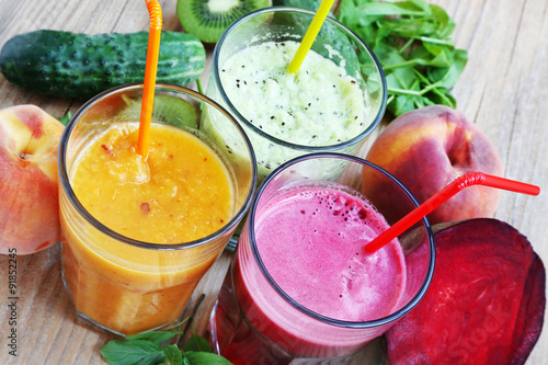Fresh Detox Juices with Beet, Peaches, Spinach and Kiwi Fruit an