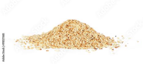 Fototapeta Heap of organic natural sesame seeds over white background obraz