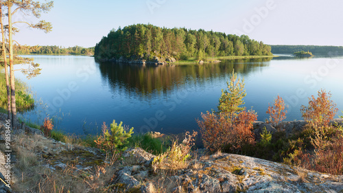 Fotografie, Obraz Ladoga lake with island under sunlight