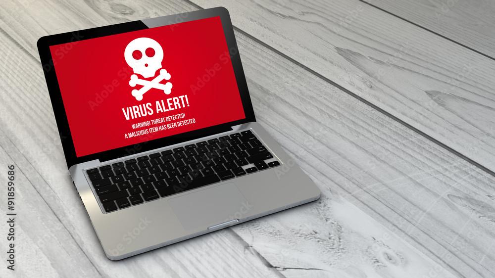 Fototapeta virus laptop over wooden tablet