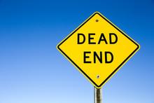 Dead End Sign Against Blue Sky