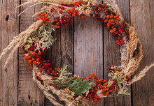 Decorative Autumn Wreath Of Berries And Leaves.