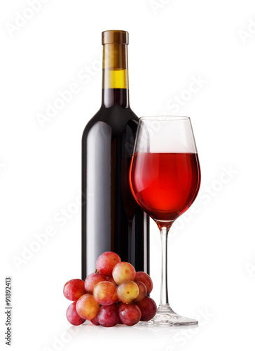 Photo  Glass and bottle of red wine with grapes