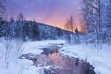 Sunrise Over A River In Winter Near Levi, Finnish Lapland