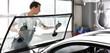 canvas print picture - Austausch der Frontscheibe in einer Werkstatt durch professionellen Automechaniker // change car glass in garage