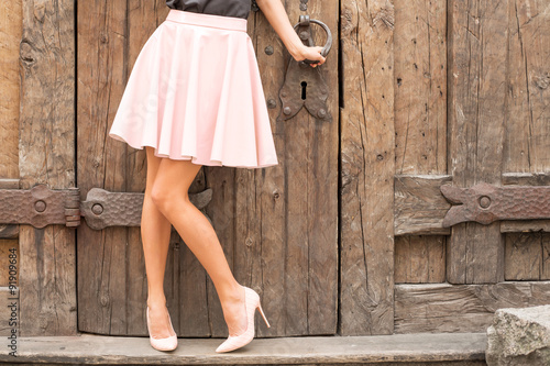 Photo Woman wearing nude colored high heel shoes
