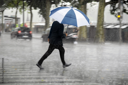 Fotografie, Obraz  Running man with umbrella in the rain