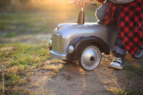 Fotografie, Obraz  Baby sitting on vintage speedster