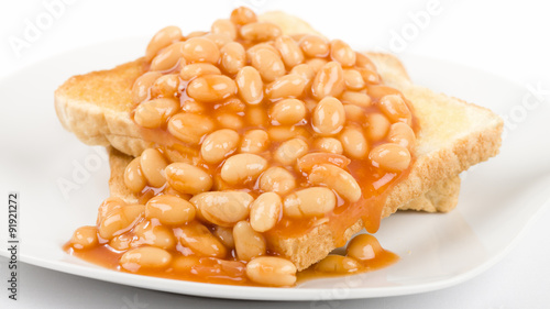 Photo  Beans on Toast - Slices of toasted white bread, buttered and topped with baked beans