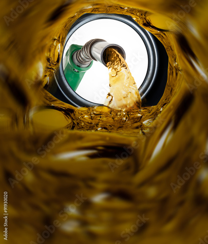 Tablou Canvas Refilling fuel view from inside of gas tank of a car