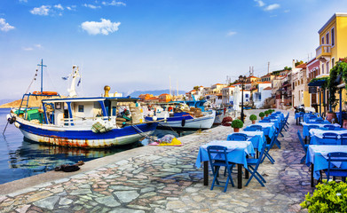 Fototapeta Do gastronomi traditional Greece series - Chalki island with old boats and tavernas