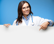 Female Doctor Showing Blank Signboard, Over Blue