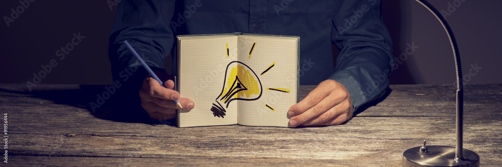 Fototapety, obrazy: Businessman or student showing his working notebook with a handd