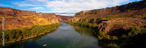 Poster Rivier Golden evening light on I. B. Perrine Bridge and the Snake at Twin Falls, Idaho