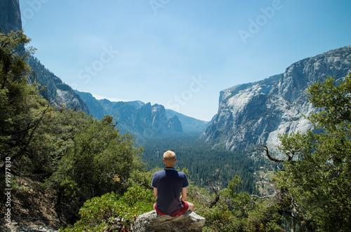Man looking at idyllic view of Yosemite National Park valley during summer vacat Canvas Print