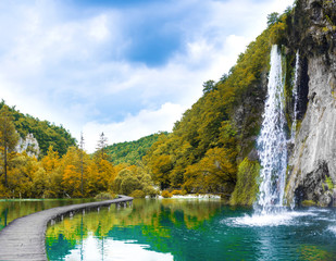 Obraz waterfall in autumn mountain forest