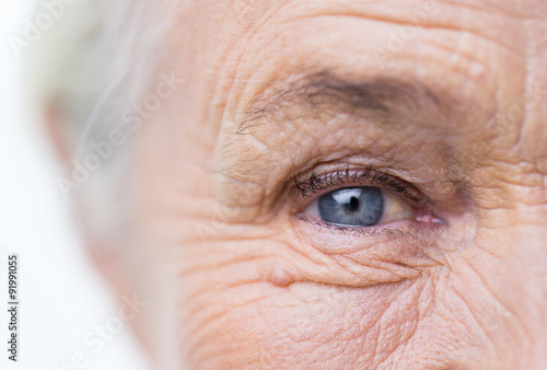 Fotografie, Obraz  close up of senior woman face and eye