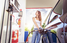 Pretty Young Woman Refuel The ...