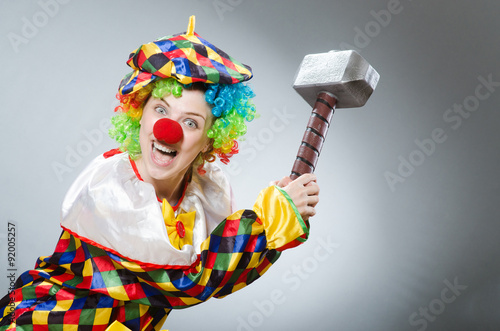 Photo Stands Indians Clown with hammer in funny concept